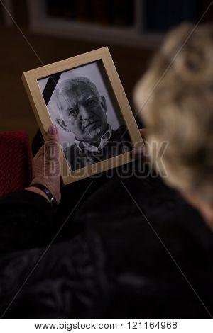 Looking At Husband Photo
