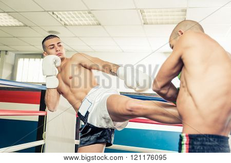 Kickboxers Training On The Ring