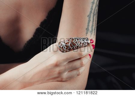 Body language, girls hand in silver ring