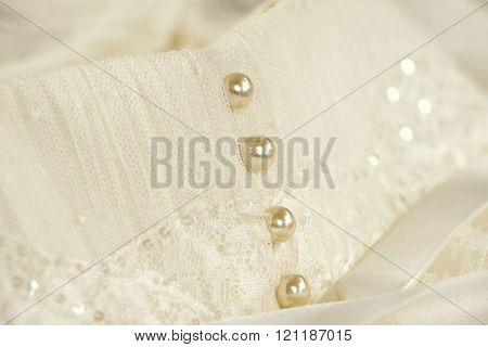 Line of pearl buttons on a wedding dress