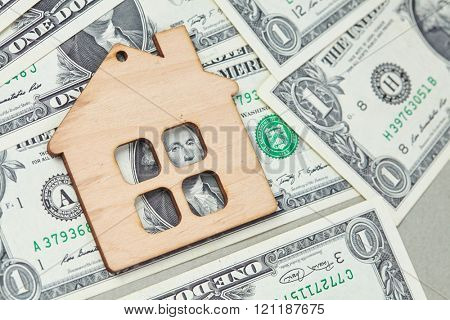 wood house and dollars