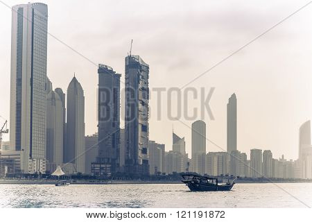 Abu Dhabi Buildings Skyline With Old Fishing Boat