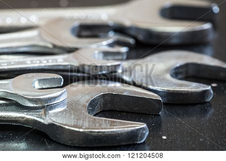 Set of the stainless steel wrench on dark background