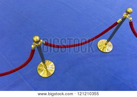Red Velvet Rope And A Blue Carpet. Abstract Background