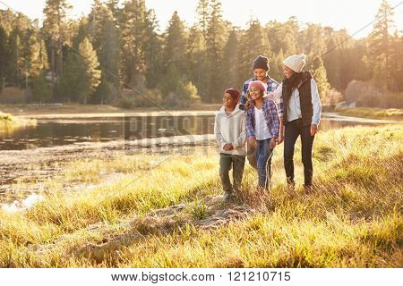 African American Family Walking By Lake