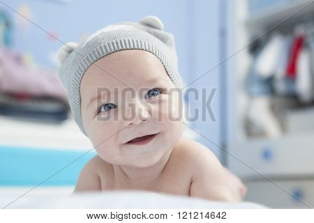 Baby with cap smiling