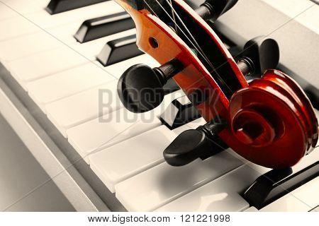 Violin on piano close up