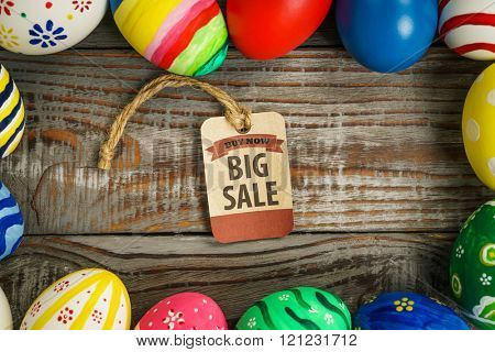 Easter eggs Sale Coupon, voucher, tag on wooden background