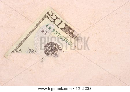 Us Paper Money Partially Buried In Beach Sand