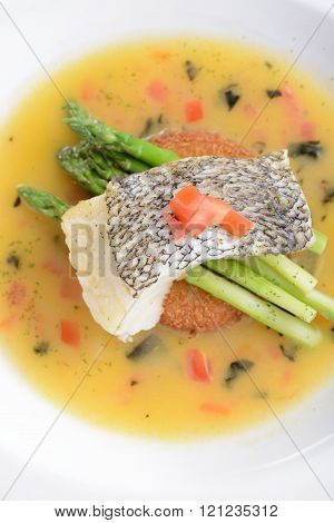 Braised cod fish on top of Asparagus