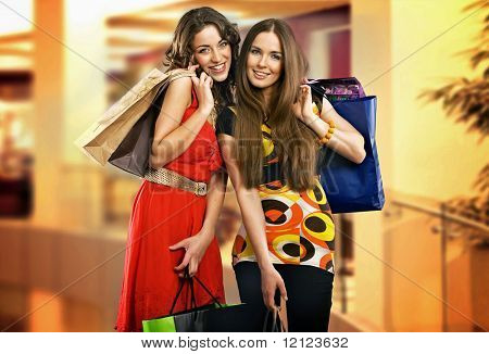 Two young women in shopping center