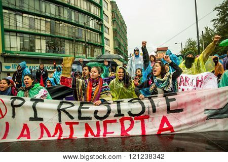 Quito, Ecuador - August 27, 2015: Group of angry mixed young people holding up banner and protesting