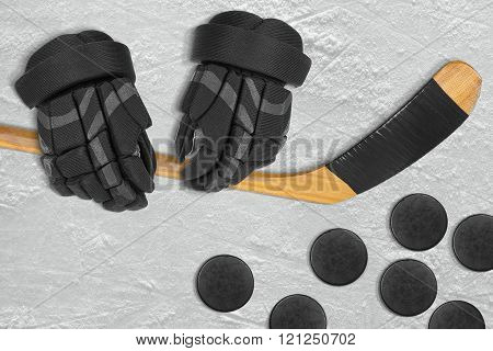 Hockey Gloves, Hockey Stick And Puck On The Ice
