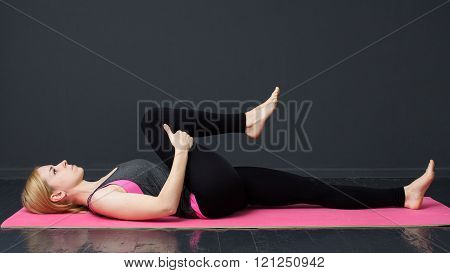 Young Woman Is Doing Yoga Workout