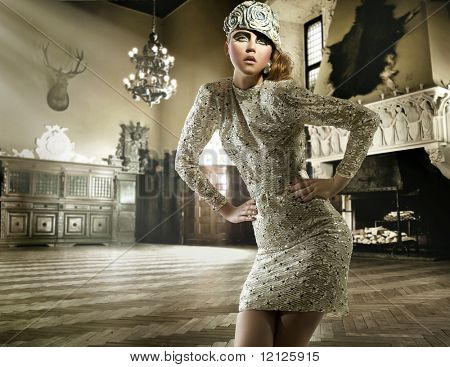 Beautiful lady posing in a vintage interior