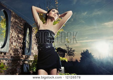 Young beauty posing at twillight