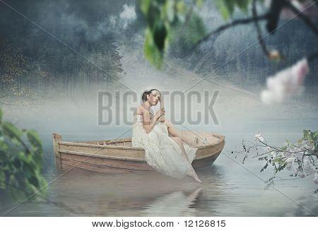 Beautiful brunette posing over beautiful romantic landscape