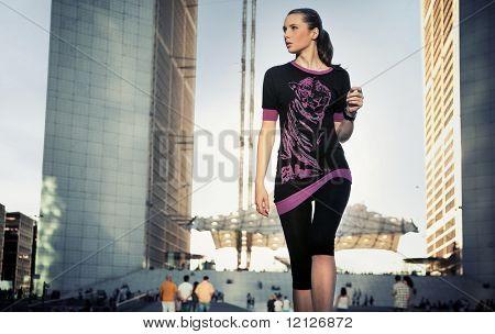 Pretty brunette over urban background