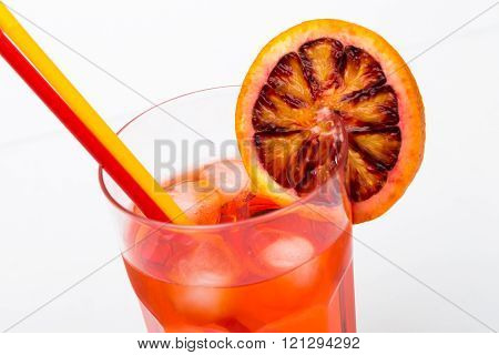 Aperol spritz aperitif alcoholic cocktail with orange slices and ice cubes isolated on white backgro