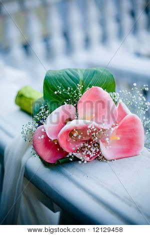 Wedding bouquet with pink calla lilies