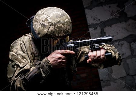 Soldier In Helmet And Tactical Mask On The Face With Gun