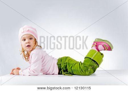 Little funny girl on white background studio shot