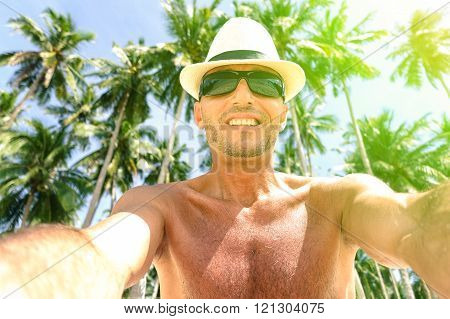 Cheerful Man Selfie With Palm Trees Background In Tropical Island - Self Male Tourist Portrait