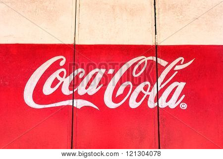 Coron,philippine - February 10 , 2016 :coca Cola Painted Logo On The Wooden Door Of Local Store