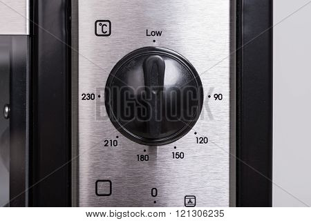 closeup temperature selector of small electric oven