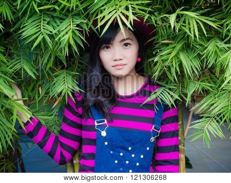 Young Hipster Fashion Asian Woman With Bambo Leaf