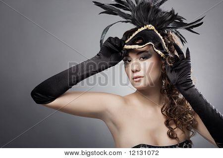 Beautiful woman wearing masquerade costume and mask