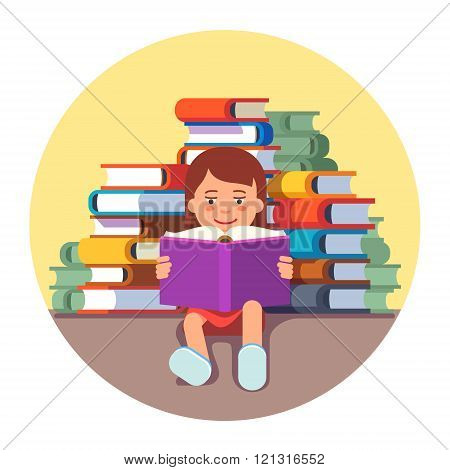 Cute girl sitting and reading a book