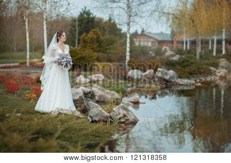 Bride On The Shore Of  Pond