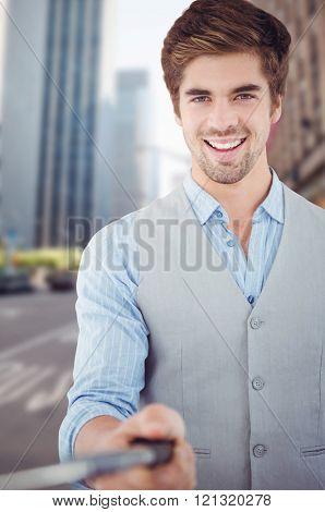 Portrait of happy businessman holding selfie stick against new york street