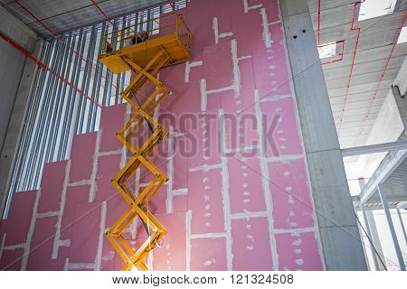Scissor Lift Platform On A Construction Site.