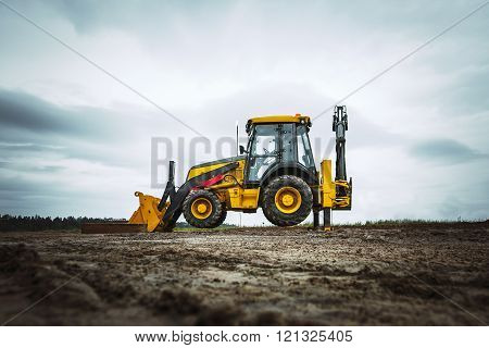 Yellow bulldozer overcome barrier
