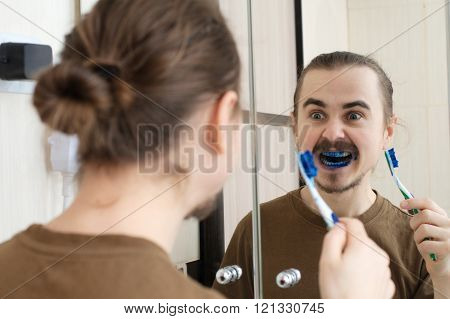 Caucasian man mad about april joke with tooth brush poster