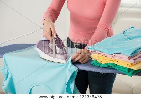 Woman Hand Ironing Clothes