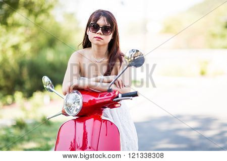 Asian Girl Waiting On The Scooter