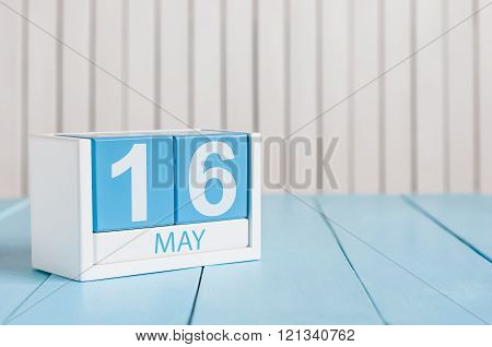 May 16th. Image of may 16 wooden color calendar on white background.  Spring day, empty space for te