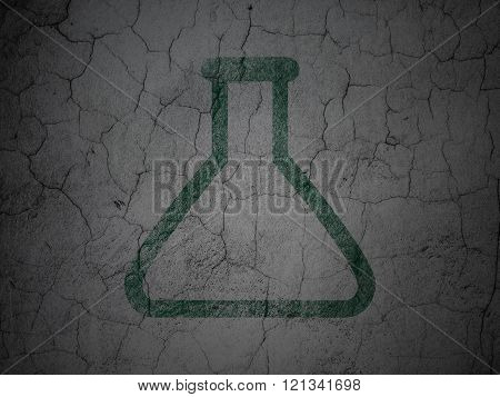 Science concept: Flask on grunge wall background