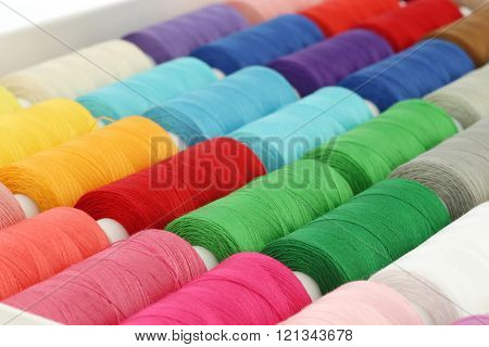 colorful spindles of yarn