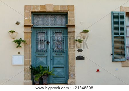 Nicosia, Cyprus - 26 February, 2016:  Classic style cyan wooden door house entrance and window in the Old City of Nicosia within the Venetian Walls