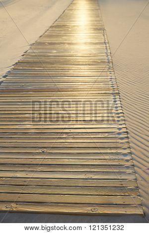 Beach wooden walkway and sand dunes texture wavy in Mediterranean