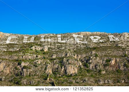 Cullera mountain with white sign writed on Valencia of Spain, sign non copyrighted