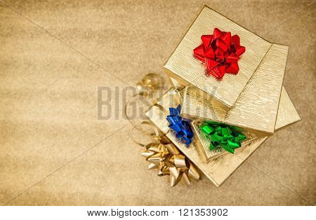 Gift Boxes With Ribbon Bow On Golden Background