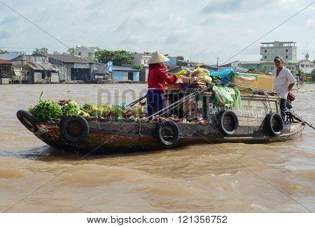 People On Floating Market In Mekong River Delta.