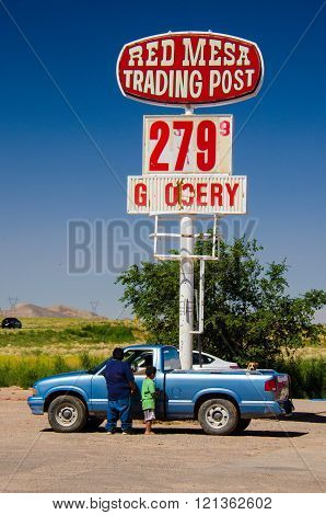 August 6, 2015 - Red Mesa, Arizona, USA: Navajo people stand by their car at Red Mesa Trading Post a