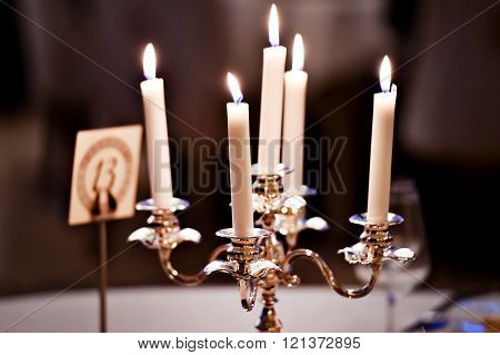Candles Burning In A Chandelier