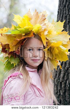 young girl portraint in autumn maple wreath